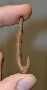 "An Extremely Rare Upper Paleolithic ""Magdalenian"" large carved bone fishing hook,  France. SOLD"